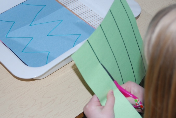 Cutting straight lines in preschool